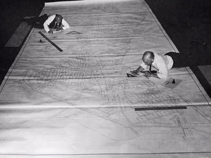 Architects editing plans in the middle of the last century